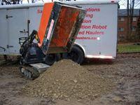 Hauler w pile of gravel sfa.JPG